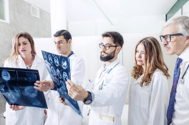 A new report suggests that improved communication between doctors, and a more open environment for discussing mistakes, could help prevent misdiagnosis. Photo by marino bocelli/shutterstock