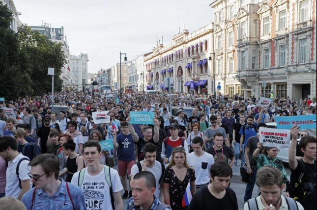 Russian opposition activists march during a protest in downtown Moscow Saturday. Photo by Yuri Kochetkov/EPA-EFE