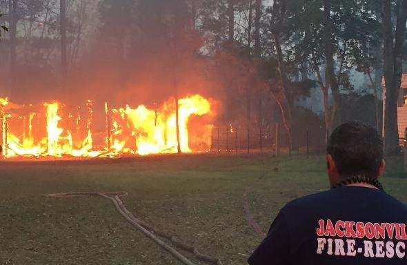 A fire, begun Wednesday by a man burning paper outdoors near Bryceville, Fla.,, became a 400-acre wildfire, destroying 10 homes and leading to the evacuation of at least 150 people. Photo courtesy of Florida Highway Patrol Jacksonville/Twitter