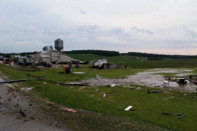 Family and friends clean up tornado damage in western Iowa