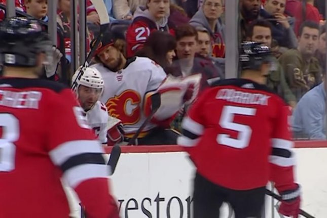 Calgary Flames goaltender Mike Smith (C) flashed the leather with a grab from the bench Wednesday night against the New Jersey Devils. Photo courtesy of NHL/YouTube