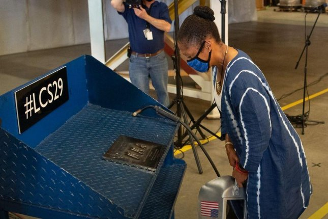 Retired Maj. Gen. Marcia Anderson looks at her initials welded into a plaque that will form the keel of the future USS Beloit, the Navy's next littoral combat ship. Photo courtesy of Lockheed Martin