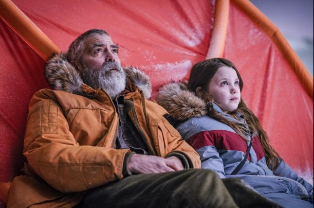 George Clooney must protect Caoilinn Springall from arctic elements in The Midnight Sky. Photo courtesy of Netflix