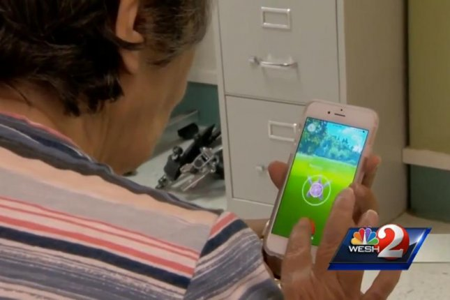 A patient at DeBary Nursing and Rehabilitation Center plays Pokemon Go as part of her treatment. Screenshot: WESH-TV