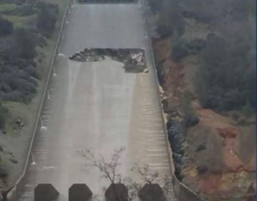 Discovery of a massive hole in the concrete spillway of the Oroville, Calif., dam forced the spillway's closure Tuesday. Screenshot from KTXL-TV, Sacramento