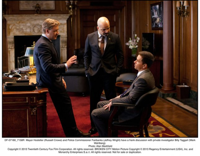 Photo of Russell Crowe, Jeffrey Wright and Mark Wahlberg[L-R] in a scene from Broken City, courtesy of Twentieth Century Fox.