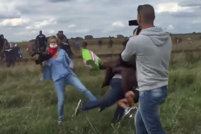 Hungarian photographer Petra Laszlo was sentenced to three years' probation by a Hungarian court after she was caught on video tripping fleeing migrants during a standoff at the Serbian-Hungarian border. Laszlo told the judge she was frightened and acting out of self-defense. Screen shot courtesy CNN