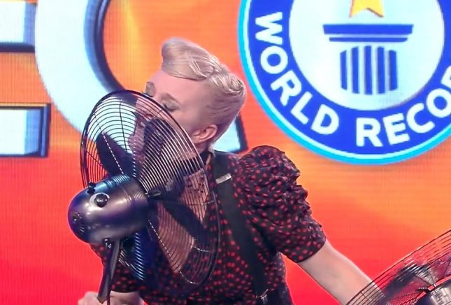 An Australian circus performer broke her own world record by stopping the blades of an electric fan with her tongue 32 times. Screen capture/Guinness World Records/YouTube