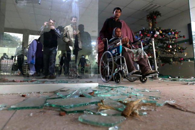Patients stand near smashed glass Wednesday at the Punjab Institute of Cardiology in Lahore, Pakistan. Photo by Rahat Dar/EPA-EFE