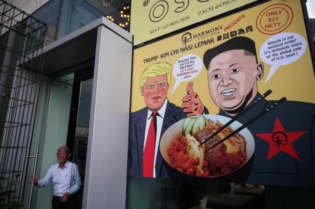 A poster is seen in Singapore on Wednesday depicting U.S. President Donald Trump, North Korean leader Kim Jong Un and a promotional dish of 'Trump-Kim Chi Nasi Lemak' at a restaurant. Photo by Wallace Woon/EPA-EFE