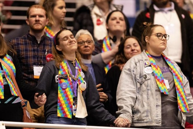 Supporters of full inclusion for LGBTQ people in United Methodist Church life hold hands in the observer's area at the 2019 United Methodist General Conference in St. Louis on February 25. Photo by Mike DuBose/UMNS