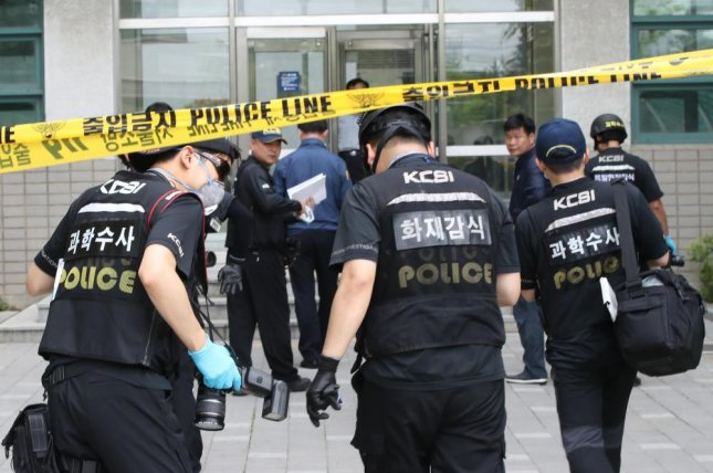 South Korea police enter a building after a reported explosion at Yonsei University in Seoul on Tuesday. Photo by EPA/Yonhap