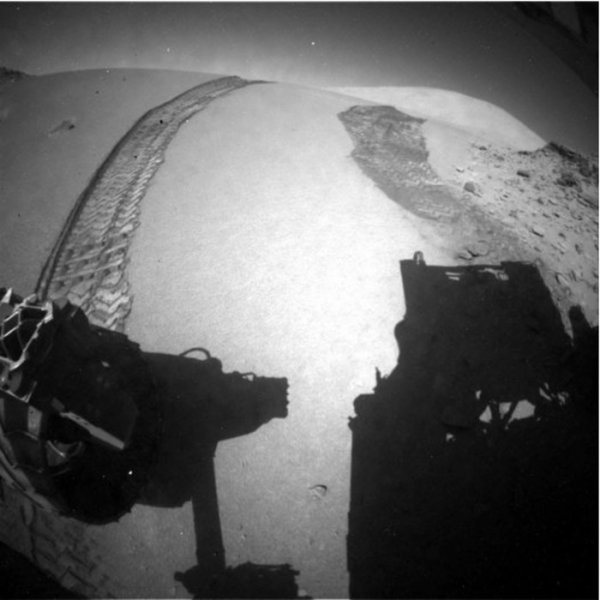 Curiosity's rear right hazard camera takes an image of its tracks down the Dingo Gap dune Thursday. Credit: JPL-Caltech
