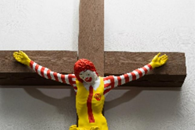 Sculpture of crucified Ronald McDonald to be pulled from