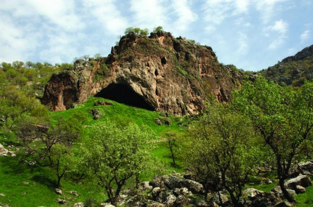 The entrance to Shanidar Cave, in the foothills of the Baradost Mountains of North-East Iraqi Kurdistan, where researchers recovered a fully articulated Neanderthal skeleton. Photo by Graeme Barke/McDonald Institute of Archaeology/University of Cambridge