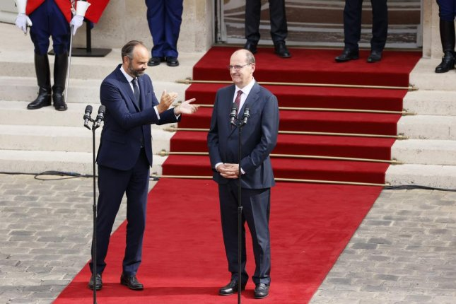 Former French Prime Minister Edouard Philippe, left, applauds newly-appointed Prime Minister Jean Castex in the courtyard of the Matignon Hotel during the handover ceremony in Paris, France, Friday. Castex has been appointed as the new French Prime Minister after the government of Edouard Philippe had resigned earlier in the day, prompting a government and cabinet reshuffle. Photo by Thomas Samson/EPA-EFE