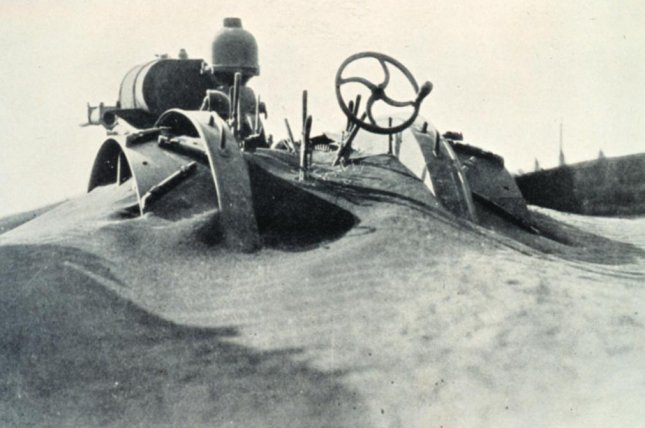 During the Dust Bowl of the 1930s, massive dust storms rolled across the Midwest, leaving fields barren and burying farm equipment. Photo by National Weather Service/NOAA