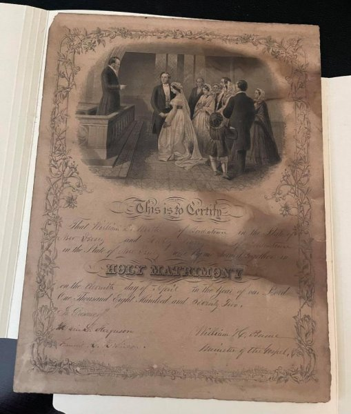 The Hope Chest Thrift Store in Bolivia is hoping to find family members connected to an 1875 marriage certificate found hidden in the frame of a recently-donated antique print. Photo by Hope Harbor Home/Facebook