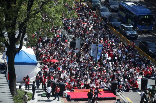 Thousands of women took to the streets in Seoul on May 19 to protest the police investigation into a spy cam case involving a female suspect. Protesters called the investigation unfair. File Photo by Yonhap