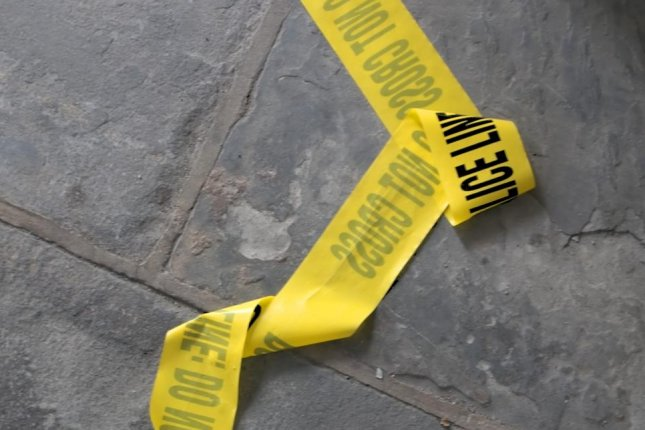 Police tape on the ground (CC/David Goehring)