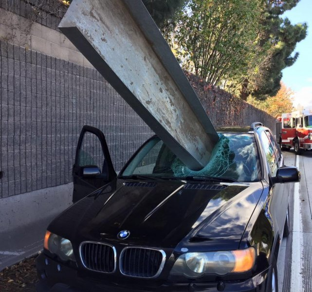 The driver of this BMW SUV walked away with only a minor scratch on his arm. Photo by San Jose Fire Fighters/Facebook