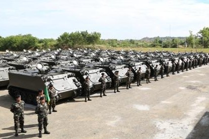 Philippine soldiers with surplus armored personnel carriers supplied by by the United States. Philippine Army photo
