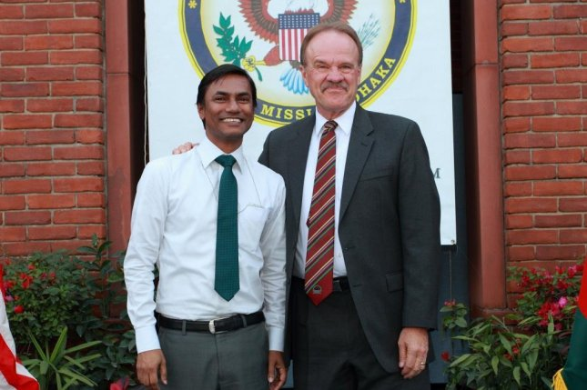 Xulhaz Mannan, who previously worked for the U.S. Embassy and USAID, is seen next to former U.S. ambassador to Angola Dan Mozena. Mannan, 35, editor of the Roopbaan LGBT magazine, was killed on Monday along with actor and friend Tanay Mojumdar. Ansar al-Islam, a group tied to al-Qaida, has claimed responsibility. Photo courtesy of Xulhaz Mannan/Facebook