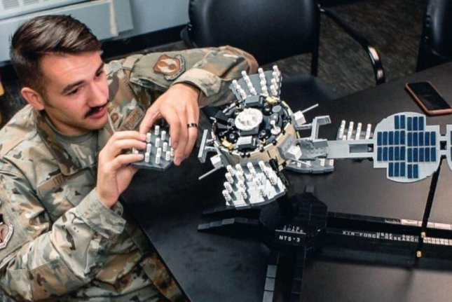 1Lt. Jacob Lutz examines a Navigation Technology Satellite-3 model at the Air Force Research Laboratory, which has partnered with colleges in a $40 million project to increase opportunities for minority students studying science and engineering. Photo courtesy of Tyrell Etsitty/AFRL