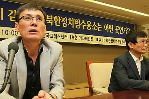 Jung Kwang-il (L) is a former North Korean political prisoner who now works as an activist in Seoul, South Korea. Jung has filed a report with the U.N. human rights office in Seoul requesting the organization launch an investigation into the whereabouts of 180 missing captives, after the camp where he was detained had closed, according to satellite imagery. File Photo by Yonhap