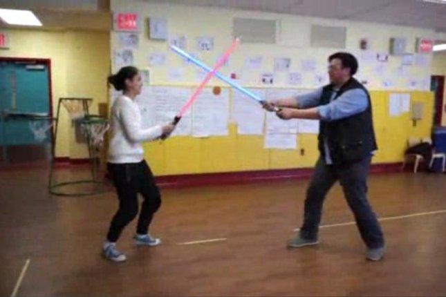 Teacher Andy Yung shows off some of the lightsaber skills he plans to teach in his Young Jedi Academy after-school program. WPIX-TV screenshot