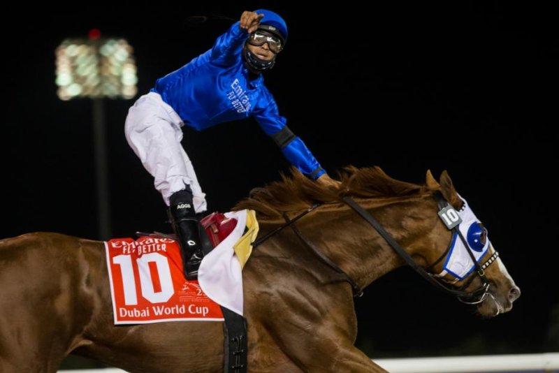 Mystic Guide wins the $12 million Dubai World Cup. Photo by Erika Rasmussen, courtesy of Dubai Racing Club