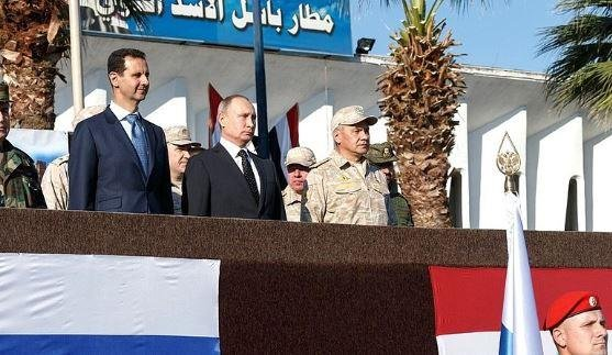 Russian President Vladimir Putin visits Syria's Khmeimin air base Monday with Syrian President Bashar al-Assad (L) and Russian Defense Minister Sergey Shoigu. Putin announced the withdrawal of Russian troops from Syria. Image courtesy the Kremlin