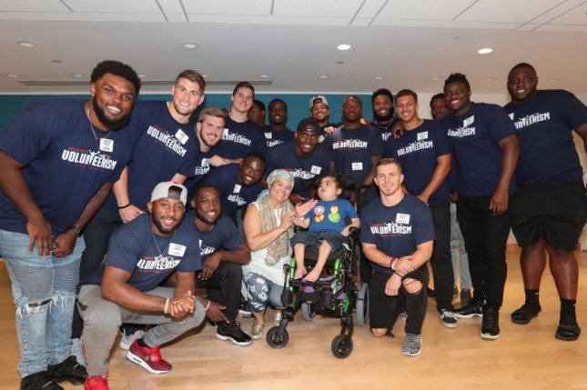 New England Patriots rookie offensive lineman Isaiah Wynn and the entire Patriots rookie class helped create several smiles when they recently visited the Boston Children's Hospital. Photo courtesy of New England Patriots/Twitter