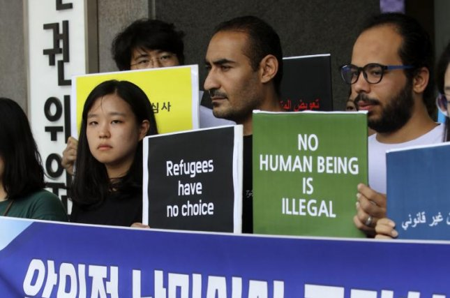 A civic group working on behalf of refugees speaks to reporters and demands a fair review for refugee applicants in front of the Human Rights Commission in Seoul on July 18. Photo by Yonhap