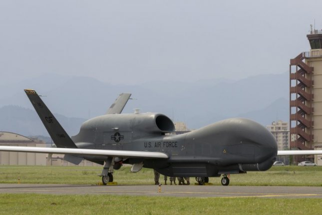 An RQ-4 Global Hawk, assigned to the 319th Operations Group Detachment 1, Andersen Air Force Base, Guam, lands at Yokota Air Base, Japan, May, 30, 2020, for a rotational deployment. The movement maintains operations for Global Hawks during months of inclement weather on Guam. Photo by Aaron Church/U.S. Air Force