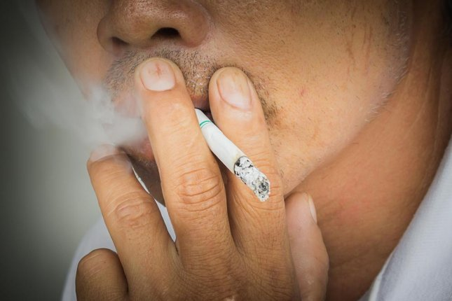 Lower-nicotine cigarettes didn't help people to quit smoking, and those who use e-cigs to quit may not know how much nicotine they consume because of mislabeled bottles of e-liquid. Photo by phonrat preecha/Shutterstock