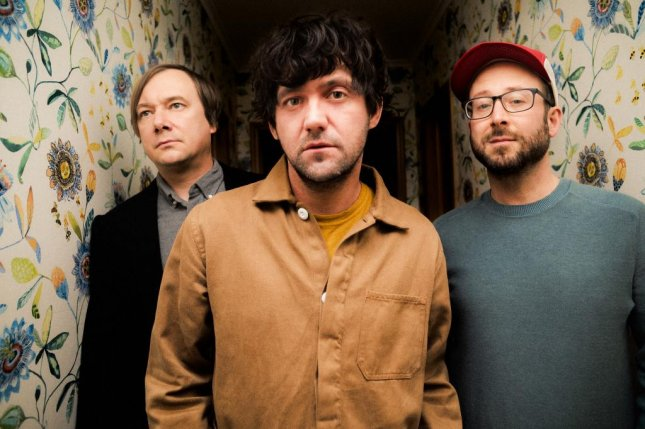 The members of Bright Eyes -- Nate Walcott (left to right) Conor Oberst and Mike Mogis -- said their new album, Down in the Weeds, Where the World Once Was, includes intentional references to their past recordings. Photo courtesy of Shawn Brackbill/Dead Oceans