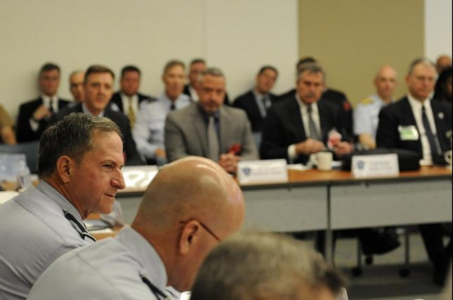 Air Force Chief of Staff Gen. David L. Goldfein (L) meets with airline executives. U.S. Air Force photo by Staff Sgt. Jannelle McRae.