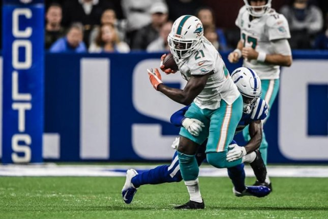 Miami Dolphins running back Frank Gore (21) is not expected to play again this season, ESPN's Adam Schefter reported on Monday. Photo courtesy of Miami Dolphins/Twitter