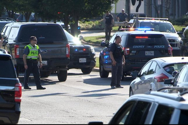 Police investigate the scene of a shooting Thursday at the offices of the Capital Gazette newspaper in Annapolis, Maryland. Five people, including four journalists, died in the attack. Photo by Greg Miller/EPA-EFE