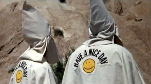 A pair of friendly klansmen stand in line to join a bad-guy posse in Mel Brooks' Blazing Saddles, one of many titles being added for streaming in March 2017. Image courtesy Warner Bros.