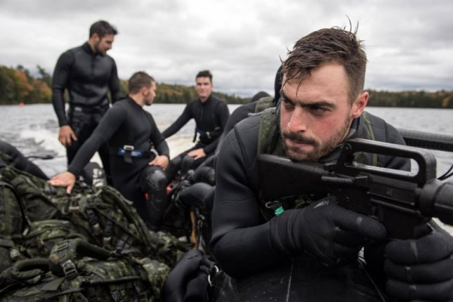 Canadian Armed Forces personnel complete a Combat Diver Course at Oromocto, New Brunswick. Canada has been criticized by other NATO countries for not raising its defense spending to two percent of GDP. Photo by Cpl. Genievieve Lapointe/Canadian Armed Forces/UPI