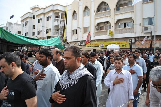 Shia Muslims take part in Ashura commemorations in Manama, Bahrain, on Nov. 25 2012. The Islamic State claimed responsibility for a lone gunman attack on Ashura celebrations in eastern Saudi Arabia that killed five people on Oct. 16, 2015. Photo by Mohamed CJ/ Wikimedia Commons