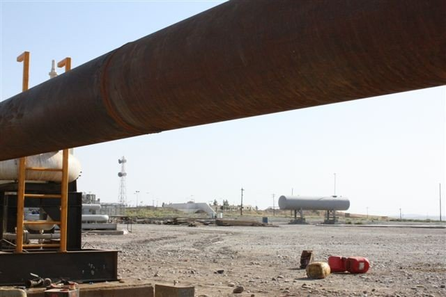 DNO's oil pipeline ends here at Faysh Khabur, near the Iraq border with Turkey and Syria. It's less than a half mile from the Iraqi government's oil metering station, seen in the background, but a deal hasn't been reached between Baghdad and the Kurdistan Regional Government to allow exports from KRG-inked deals. (Ben Lando/UPI)