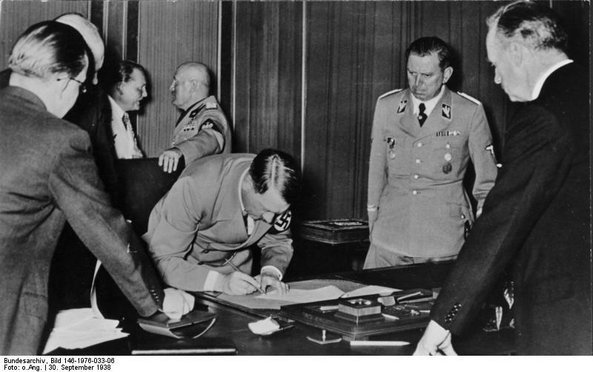 Hitler, Mussolini, Goring and others at the signing of the Munich Agreement in 1938, courtesy of the German Federal Archives via Wikimedia Commons.