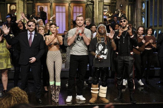 Pictured: (l-r) Congressman-elect and Navy Veteran Dan Crenshaw, singer Halsey, guest host Liev Schreiber, musical guest Lil Wayne, and Swizz Beatz at the end of this weekend's edition of Saturday Night Live. Photo by Will Heath/NBC