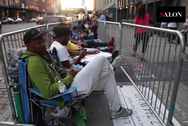 Same Ole Line Dudes Robert Samuel and Adonis Porch wait in line outside a New York Apple store. Salon/YouTube video screenshot