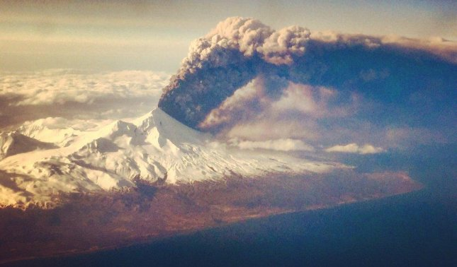 Pavlof volcano erupts in the Aleutian Islands with a huge ash plume on Sunday. This picture was taken from a plane en route to Anchorage from Dutch Harbor, Alaska. Photo courtesy of Colt Snapp/Alaska Volcano Observatory