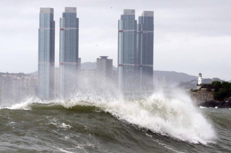 Strong typhoon barrels towards flood-hit western Japan