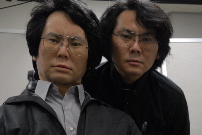 Japanese robotics engineer Hiroshi Ishiguro (right) and his Geminoid android. (Hiroshi Ishiguro Laboratory/ATR)